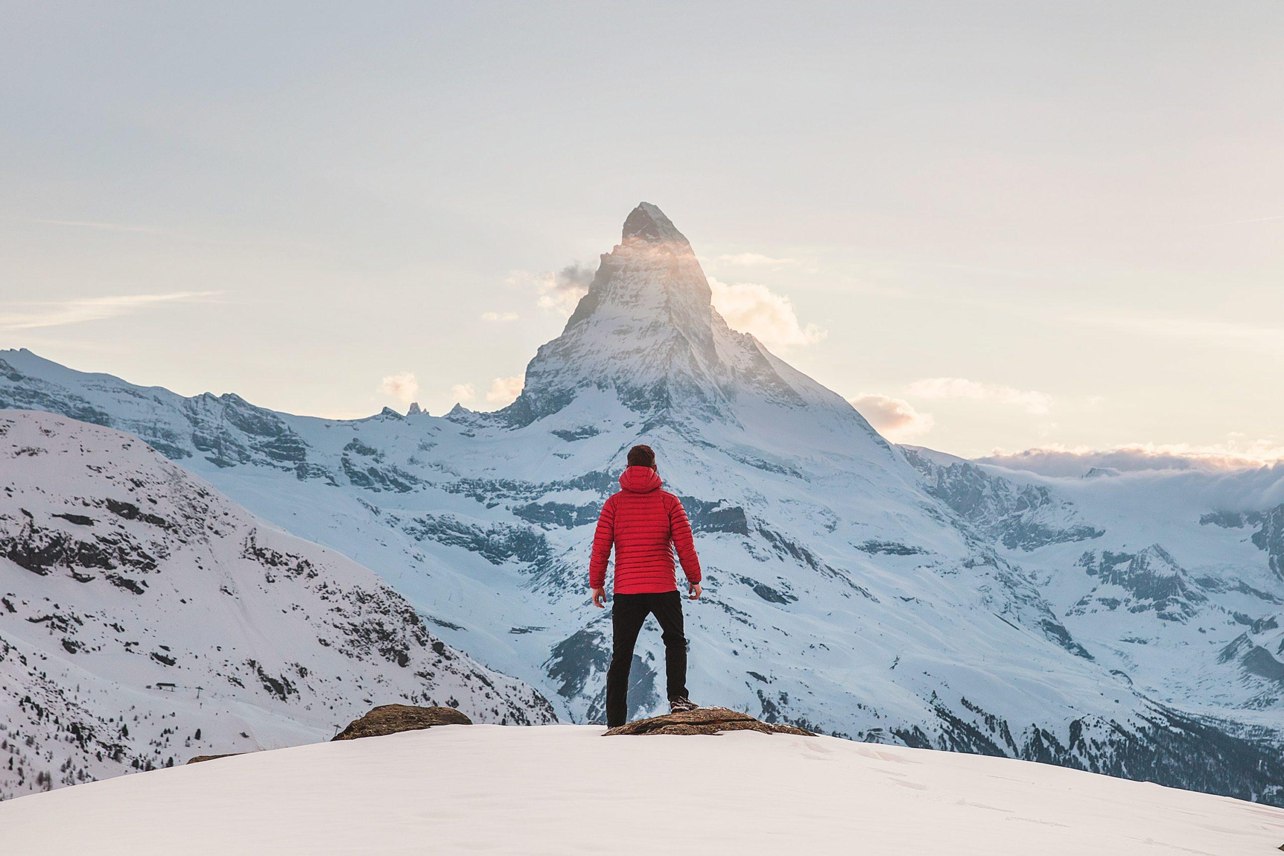 Image: man preparing to hike up a mountain